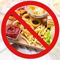 Señal de prohibido a la comida basura
